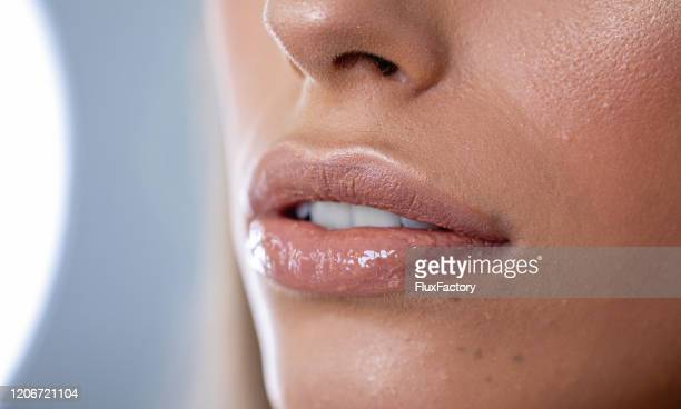 glowy lips - lip gloss stock pictures, royalty-free photos & images