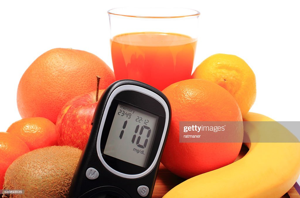 Glucometer, fresh natural fruits and glass of juice : Stock Photo