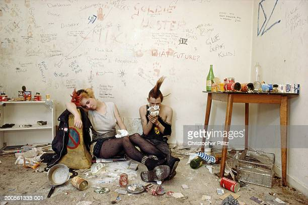Glue sniffers inhaling intoxicants in squat
