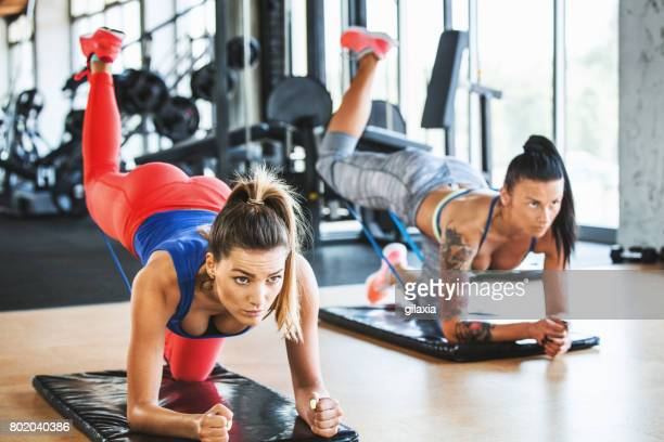 glute kickbacks. - woman bum stock photos and pictures