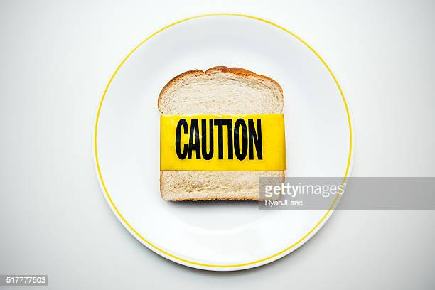 gluten and wheat allergy caution - danger stock photos and pictures