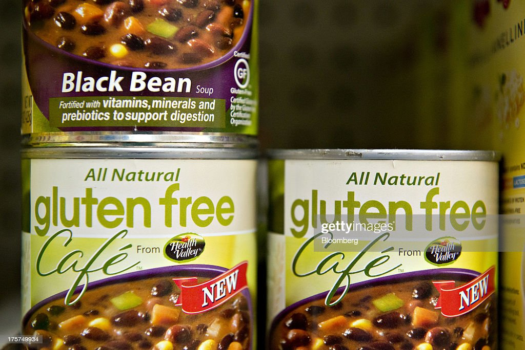 'Gluten Free' appears on cans of black bean soup at a supermarket in Princeton, Illinois, U.S., on Wednesday, Aug. 7, 2013. On Aug. 2, the U.S. Food and Drug Administration defined Ògluten-freeÓ as food that contains less than 20 parts per million of gluten, a protein found in wheat, rye and barley. Food makers will have one year to ensure labels on their cans and boxes meet the standard. Photographer: Daniel Acker/Bloomberg via Getty Images