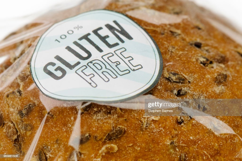 """100% Gluten Free"" sticker on a loaf of brown seeded bread. : Stock Photo"