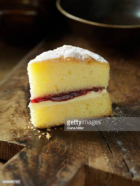 gluten free victoria sponge cake, jam, cream, wooden chopping board - sponge cake stock pictures, royalty-free photos & images