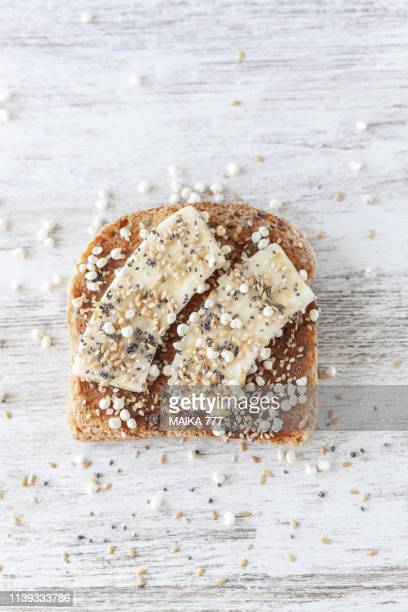 gluten free whole grain bread with almond butter, banana, puffed millet with honey, golden flax, chia, sesame and poppy seeds - gluten free bread stock pictures, royalty-free photos & images