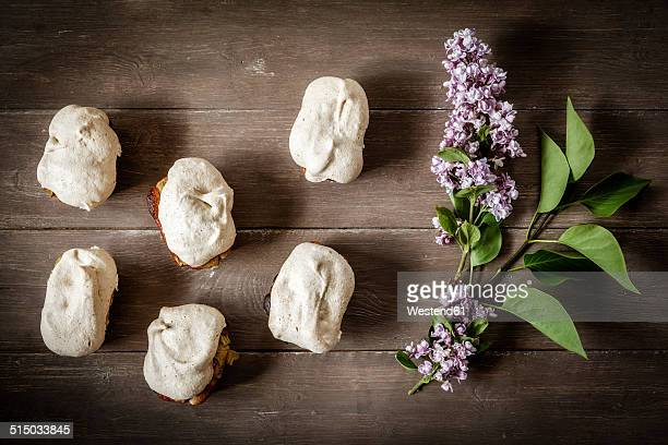 Gluten-free rhubarb cake with meringue and blossoms of lilac, elevated view
