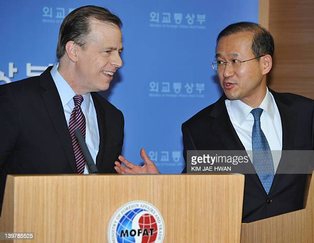 Glyn Davies coordinator for US policy on North Korea listens to South Korea's nuclear envoy Lim SungNam during a press conference in Seoul on...