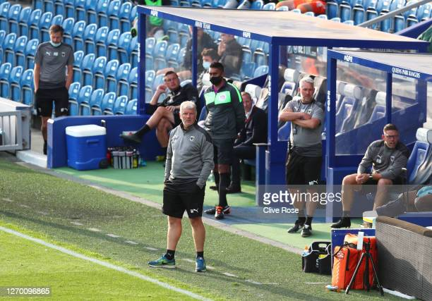 Glyn Hodges manager of AFC Wimbledon looks on from the bench during the EFL Trophy match AFC Wimbledon and Charlton Athletic at The Kiyan Prince...