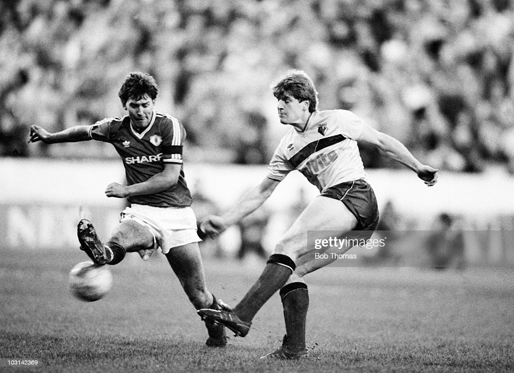 Glyn Hodges of Watford (right) attempts to shoot past Bryan Robson of Manchester United during a Division One football match held at Vicarage Road, Watford on 2nd January 1988. Manchester United beat Watford 1-0.