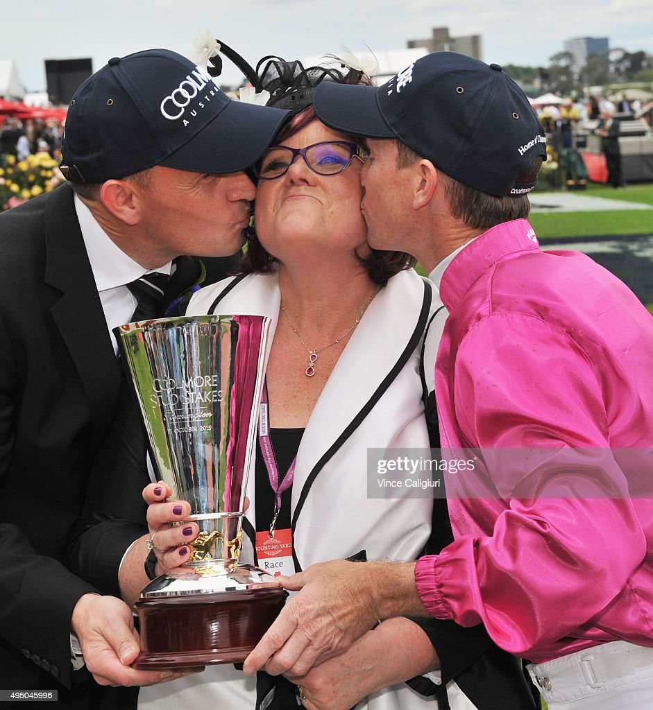 Glyn Schofield and Trainer Chris Waller kiss part owner Debbie Kepitis after Japonisme won Race 4, the Coolmore Stud Stakes on Derby Day at Flemington Racecourse on October 31, 2015 in Melbourne, Australia.
