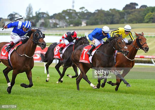 Glyn Schofield riding Beautiful Romance defeats Damien Oliver riding Almoonqith and Damian Lane riding Big Orange in Race 7 Zipping Classic during...