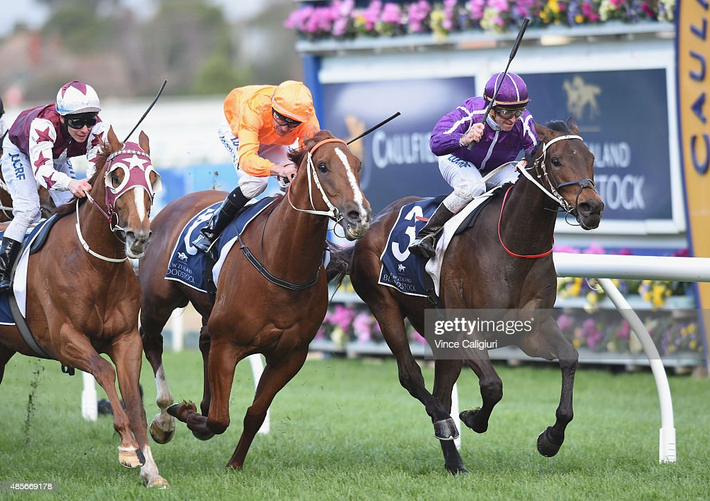 Glyn Schofield riding Boban (r) defeats Dwayne Dunn riding Entirely Platinum and Ben Melham riding Stratum Star (L) in Race 8, the Memsie Stakes during Melbourne racing at Caulfield racecource on August 29, 2015 in Melbourne, Australia.