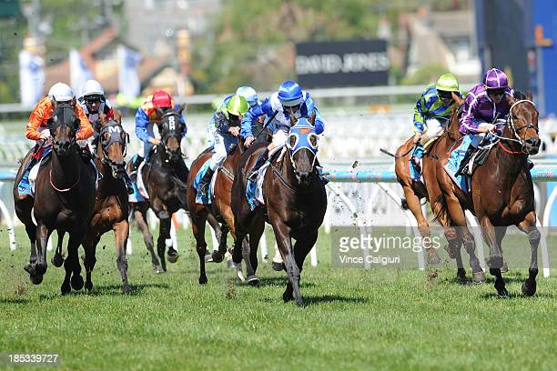 Glyn Schofield riding Boban defeats Luke Nolen riding Strawberry Boy in the Sportingbet Moonga Stakes during Caulfield Cup day at Caulfield...