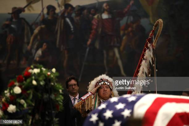 Glynn Crooks of the Shakopee Mdewakanton Sioux tribe from Minnesota salutes as the lateSen John McCain lies in state during a memorial service in his...