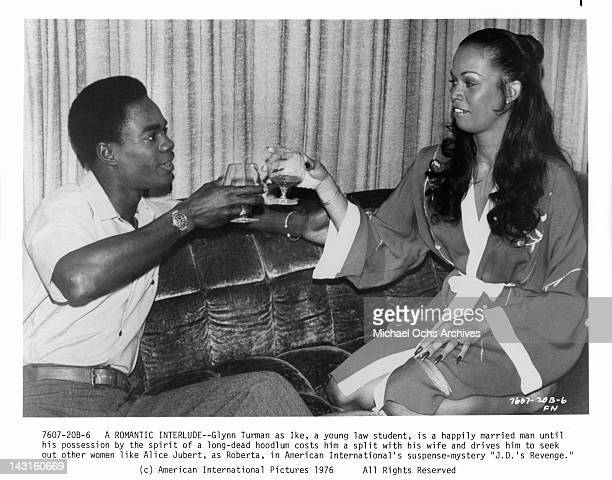 Glynn Turman having drink with Alice Jubert in a scene from the film 'JD's Revenge' 1976