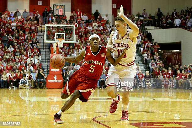 Glynn Watson Jr #5 of the Nebraska Cornhuskers dribbles the ball while being guarded by Zach McRoberts of the Indiana Hoosiers in the second half at...