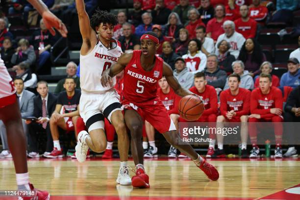 Glynn Watson Jr #5 of the Nebraska Cornhuskers in action against Geo Baker of the Rutgers Scarlet Knights during a game at Rutgers Athletic Center on...