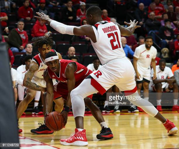 Glynn Watson Jr #5 of the Nebraska Cornhuskers in action as Corey Sanders and Mamadou Doucoure of the Rutgers Scarlet Knights defends during a game...