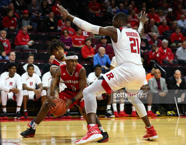 Glynn Watson Jr #5 of the Nebraska Cornhuskers looks to get past Mamadou Doucoure of the Rutgers Scarlet Knights during the first half of a game at...
