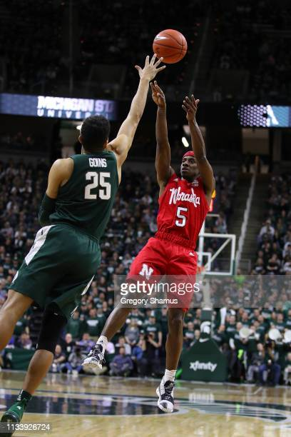 Glynn Watson Jr #5 of the Nebraska Cornhuskers takes a shot over Kenny Goins of the Michigan State Spartans during the second half at Breslin Center...