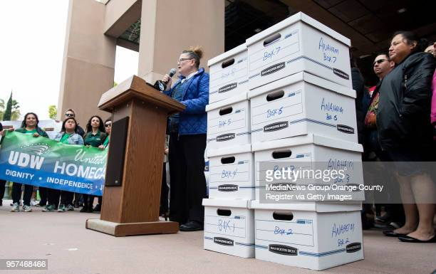 Glynndana Shevlin a food and beverage concierge at the Disneyland Hotel speaks a press conference where the Anaheim Union Coalition delivered 22000...