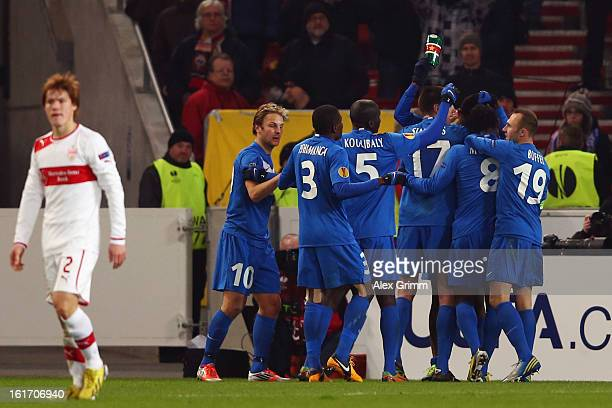 Glynor Plet of Genk celebrates his team's first goal with team mates during the UEFA Europa League Round of 32 first leg match between VfB Stuttgart...