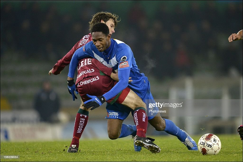 Glynor Plet of KRC Genk is fouled by Karel D'Haene of Zulte-Waregem during the Cofidis Cup 1/4 final away match between SV Zulte Waregem and KRC Genk in the Regenboog stadium on December 13, 2012 in Waregem, Belgium.