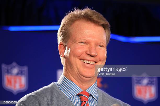 NFL gmae analyst Phil Simms speaks during a press conference for the FedEx Air Ground NFL Players of the Year in the Super Bowl XLVI Media Center at...