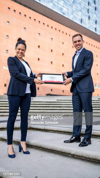 DFB EURO GmbH special advisor Celia Sasic and DFB EURO GmbH executive director Philipp Lahm present Hamburg as official playing venue during a visit...