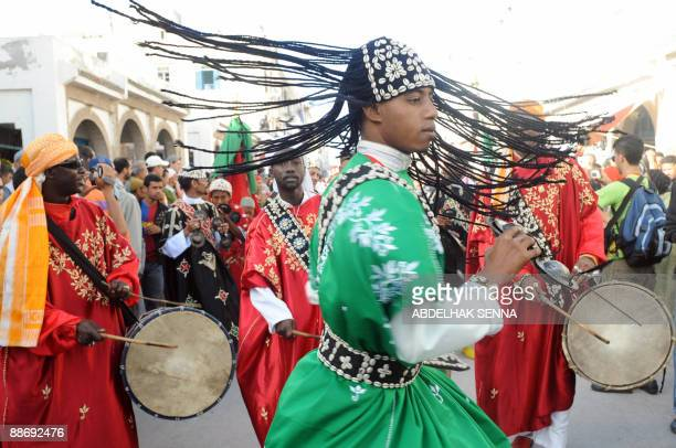 Gnaoua musicians perform during the opening of the 12th Gnaoua Festival and Musics of the World of Essaouira on June 25 2008 The 12th edition of the...