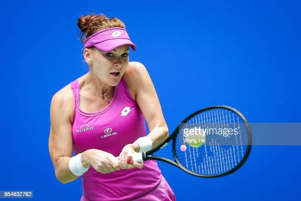 gnieszka Redwanska of Poland returns a shot during the match against Ashleigh Barty of Australia on Day 4 of 2017 Dongfeng Motor Wuhan Open at Optics...
