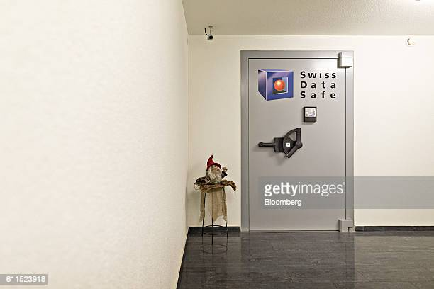 A gnome doll sits on display outside the door to a vault inside the Swiss Data Safe AG formermilitary bunker secure storage facility in Amsteg...