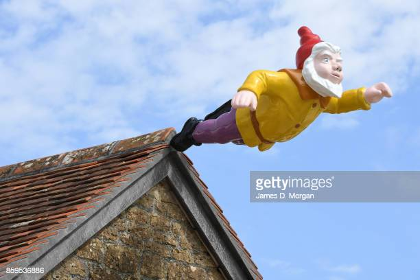 Gnome flying off building rooftop part of an exhibition by Djordje Ozbolt's showing at Hauser and Wirth in Burton United Kingdom in April 16th 2017