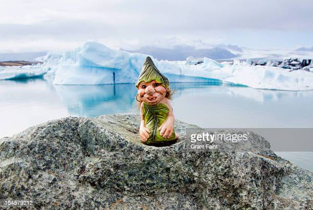 gnome on rock. - gnome stock pictures, royalty-free photos & images