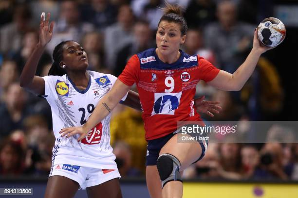 Gnonsiane Niombla of France and Nora Mork of Norway challenges for the ball during the IHF Women's Handball World Championship final match between...