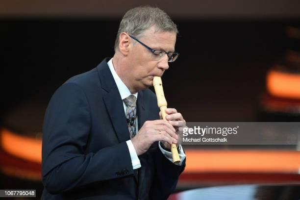 Günther Jauch plays flute on stage during the tv show '2018 Menschen Bilder Emotionen' on December 3 2017 in Cologne Germany