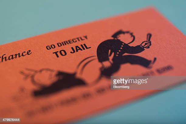 A Go Directly To Jail Chance card is arranged on a Hasbro Inc Monopoly board game for a photograph taken with a tiltshift lens in Oradell New Jersey...
