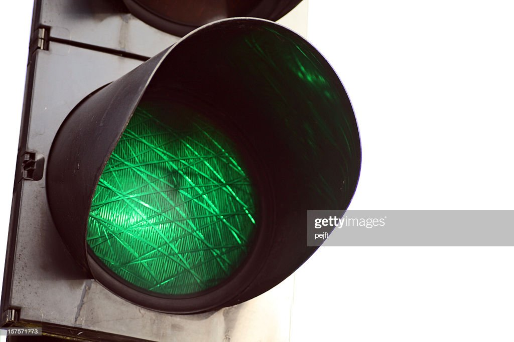 Go - green light traffic signal on white background : Stock Photo