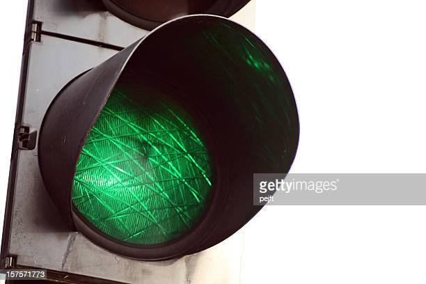 go - green light traffic signal on white background - pejft stock pictures, royalty-free photos & images