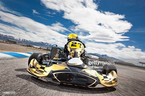 go kart racer speeding around track - motorsport stock pictures, royalty-free photos & images