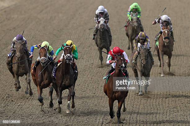 Go Maggie Go ridden by Luis Saez leads the field to win The 92nd Running of BlackEyed Susan Stakes at Pimlico Race Course on on May 20 2016 in...