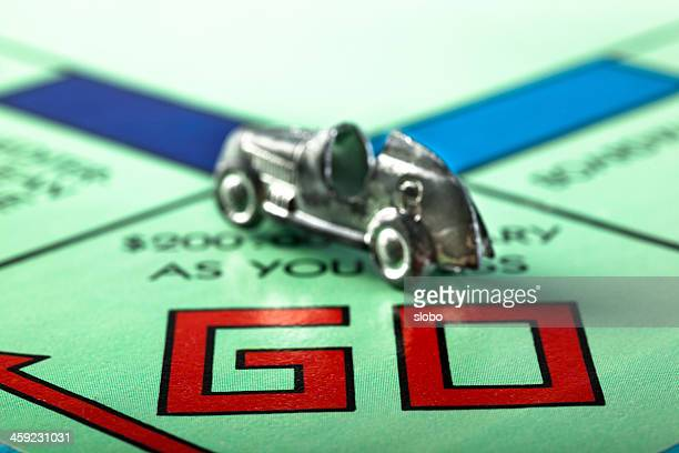 go monopoly - game board stock photos and pictures