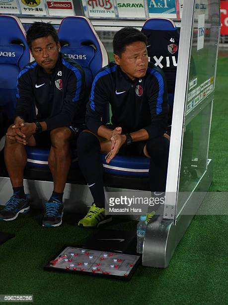 Go Oiwacoach of Kashima Antlers looks on prior to the JLeague match between Yokohama FMarinos and Kashima Antlers at the the Nissan Stadium on August...