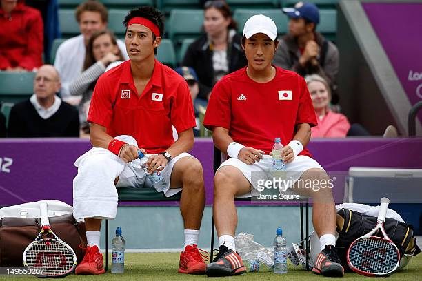 Go Soeda and Kei Nishikori of Japan look on during a break in their Men's Doubles Tennis match against Stanislas Wawrinka and Roger Federer of...