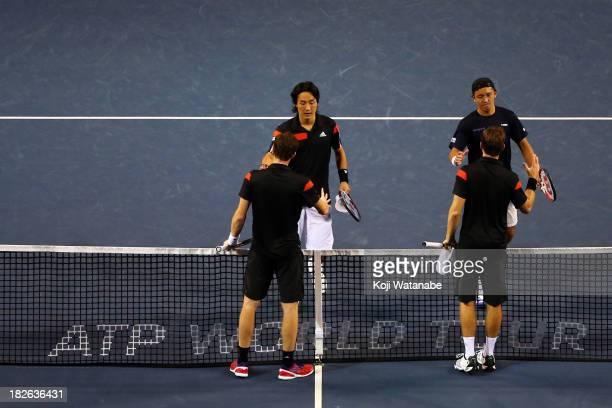 Go Soeda of Japan and Tatsuma Ito of Japan shake hands with Jamie Murray of the Great Britain and John Peers of Australia after the men's first round...