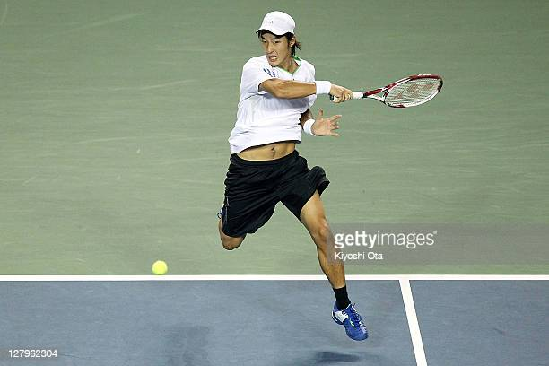 Go Soeda of Japan hits a forehand in his first round match against Rafael Nadal of Spain during day two of the Rakuten Open at Ariake Colosseum on...
