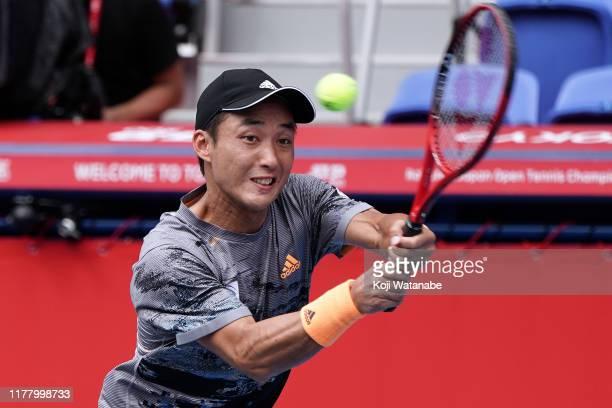 Go Soeda of Japan hits a return shot against Lennard Struff of Germany on day one of the Rakuten Open at the Ariake Coliseum on September 30 2019 in...