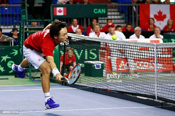 Go Soeda of Japan hits the net as he misses a shot against Vasek Pospisil of Canada during their Davis Cup match March 8 2015 in Vancouver British...