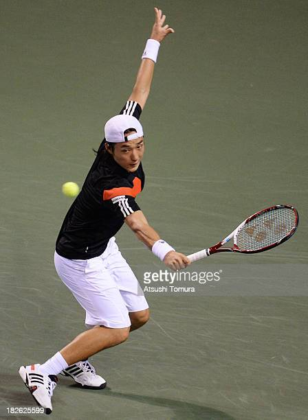 Go Soeda of Japan in action during his men's first round match against Milos Raonic of Canada during day three of the Rakuten Open at Ariake...