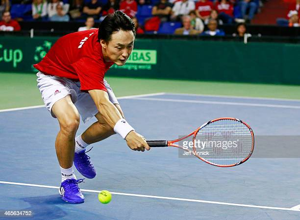 Go Soeda of Japan misses a shot against Vasek Pospisil of Canada during their Davis Cup match March 8 2015 in Vancouver British Columbia Canada...